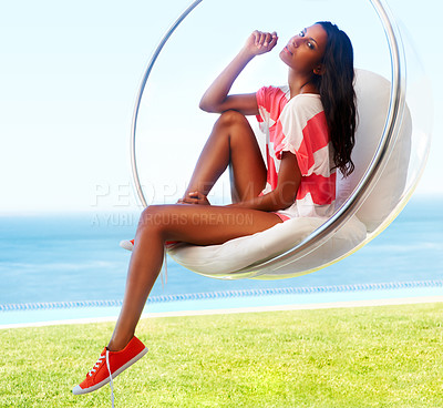 Buy stock photo Woman sitting in chair outdoors looking at camera with shoes and T-shirt one and bottom half exposed.