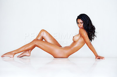Buy stock photo Portrait of a seductive nude woman leaning backwards on a white background