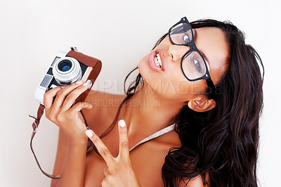 Buy stock photo Portrait of a young topless woman wearing glasses holding a camera
