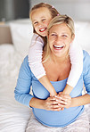 Sweet young girl and mother in a playful mood