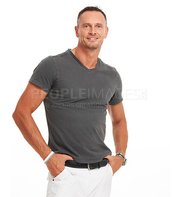 Buy stock photo Casual mature man standing smiling with his hands in his pockets isolated on white