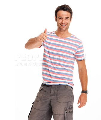 Buy stock photo Positive young man giving the thumbs up while isolated on white and smiling
