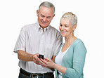 Senior couple reading SMS on a cell phone on white