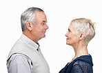 Profile view of loving old couple looking at eachother on white