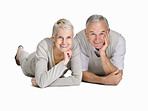 Happy old couple lying on floor and smiling against white
