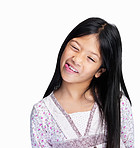 Happy young girl sticking out her tongue isolated on white