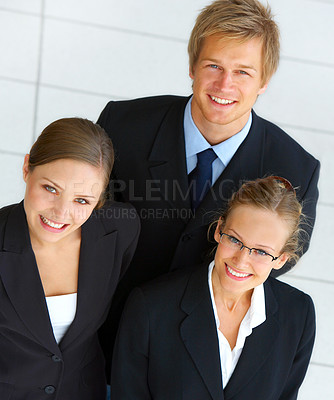 Buy stock photo Portrait of three businesspeople standing in the office