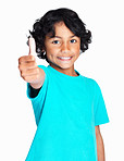 Happy boy gesturing a success sign against white