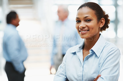 Buy stock photo Smart young confident business woman with coworkers in the background