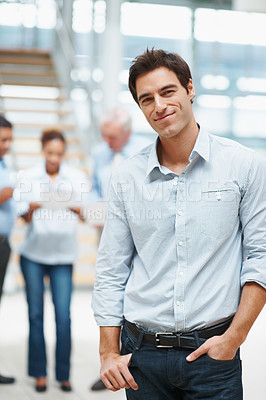 Buy stock photo Smart young business man with colleagues in discussion at the background