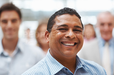 Buy stock photo Closeup of successful business man smiling with colleagues at the back