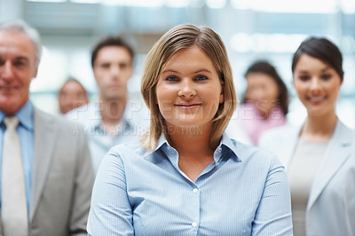 Buy stock photo Portrait of a beautiful young business woman with co workers  in the back