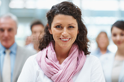 Buy stock photo Business leadership - Group with focus on attractive executive standing in front
