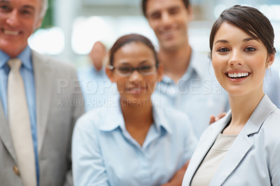 Buy stock photo Portrait of young business executive smiling with colleagues