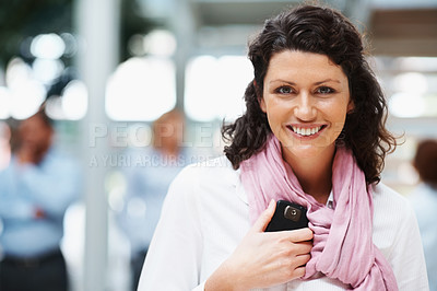 Buy stock photo Portrait of a happy middle aged business executive with colleagues in the background
