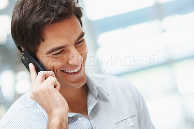 Buy stock photo Closeup of a smiling smart young man talking over the cellphone