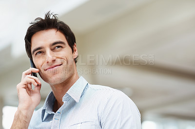 Buy stock photo Handsome young guy using a mobile phone with copyspace
