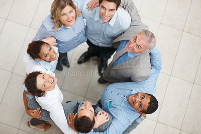 Buy stock photo Top view of a team of business colleagues standing in a huddle