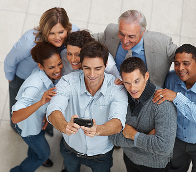 Buy stock photo Top view of multi ethnic business people posing for a self team photograph