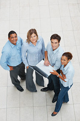 Buy stock photo Top view of happy multi ethnic business people working on a laptop