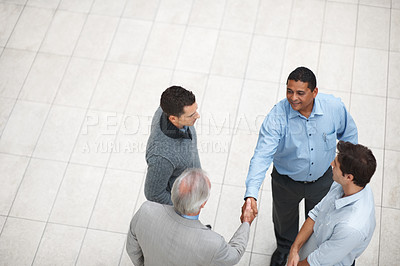 Buy stock photo Business deal - Top view of a business leaders handshaking at work