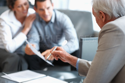 Buy stock photo Financial advisor explaining investment plans to a couple