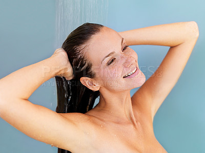 Buy stock photo Pretty young woman washing her hair with a smile in the shower