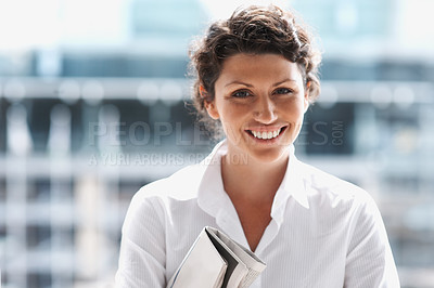 Buy stock photo Confident mature business woman smiling against blur background