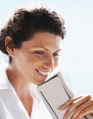 Buy stock photo Closeup of a thoughtful middle aged business woman smiling against white