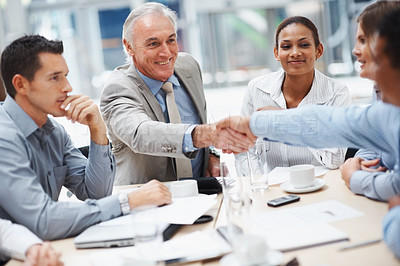 Buy stock photo Good work - Senior business man congratulating a co worker during a meeting