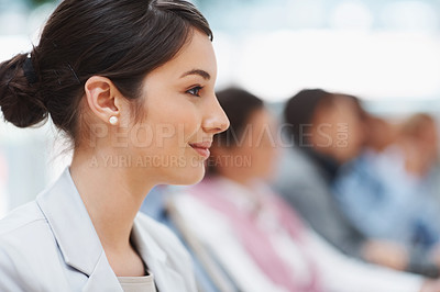 Buy stock photo Closeup profile image of a successful young business executive at a conference