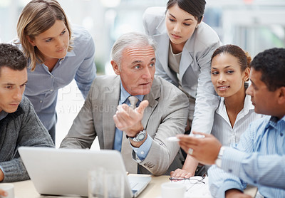 Buy stock photo Business meeting - Senior manager discussing work with his colleagues