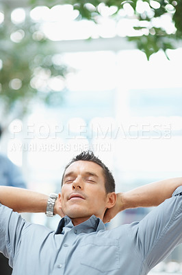 Buy stock photo Portrait of a successful business executive relaxing with lots of copyspace