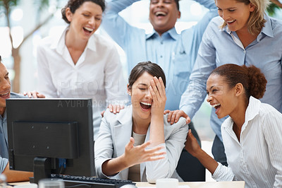 Buy stock photo Business woman sitting in front of computer with colleagues and laughing at a funny email