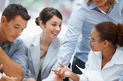 Buy stock photo Smiling business people having a discussion at a meeting