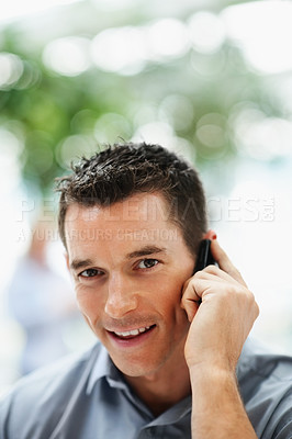Buy stock photo Closeup of a handsome business man having a conversation on the cellphone