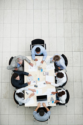 Buy stock photo Meeting - Top view of a business team sitting at a table for discussion