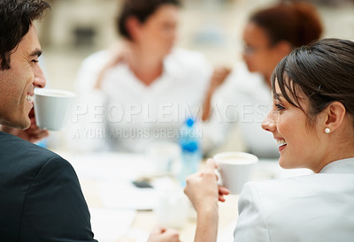 Buy stock photo Business colleagues looking at eachother with coffee cups in their hand during office break