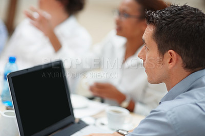 Buy stock photo Young business man with a laptop seated for a meeting