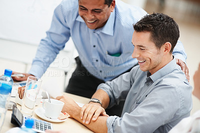 Buy stock photo Smiling business colleagues having a good time during the office break
