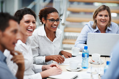 Buy stock photo Happy business woman sitting along with other colleagues at a meeting