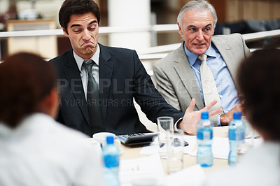 Buy stock photo Unsatisfied business deal - Young executive not happy with a business proclamation