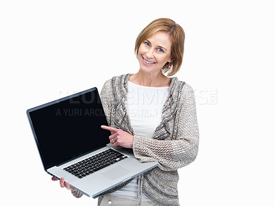 Buy stock photo Portrait  of a pretty mature lady pointing to a laptop screen over white background