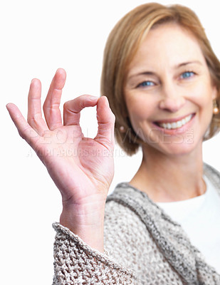 Buy stock photo Portrait of happy mature lady showing the ok sign isolated over white background