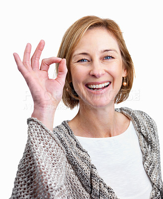 Buy stock photo Portrait of pretty middle aged woman showing the ok sign over white background