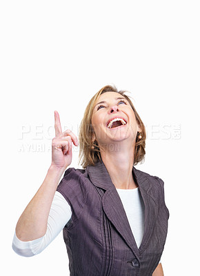 Buy stock photo Portrait of cheerful mature woman pointing upwards isolated over white background