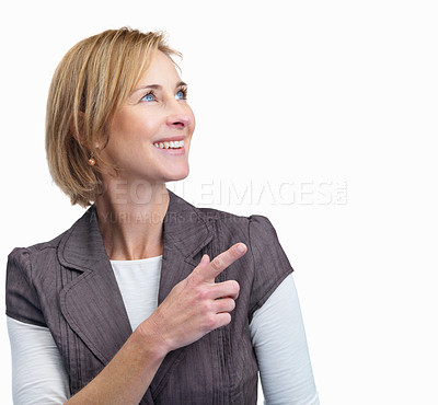 Buy stock photo Portrait of happy mature woman pointing at copyspace isolated over white background