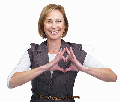 Buy stock photo Portrait of happy mature lady showing heart sign isolated over white background