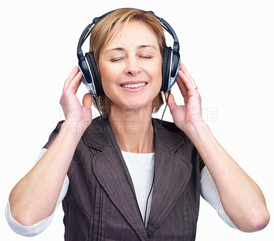 Buy stock photo Portrait of a happy mature woman listening to music on headphones isolated over white background