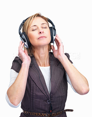 Buy stock photo Portrait of middle aged woman listening to music with eyes closed over white background